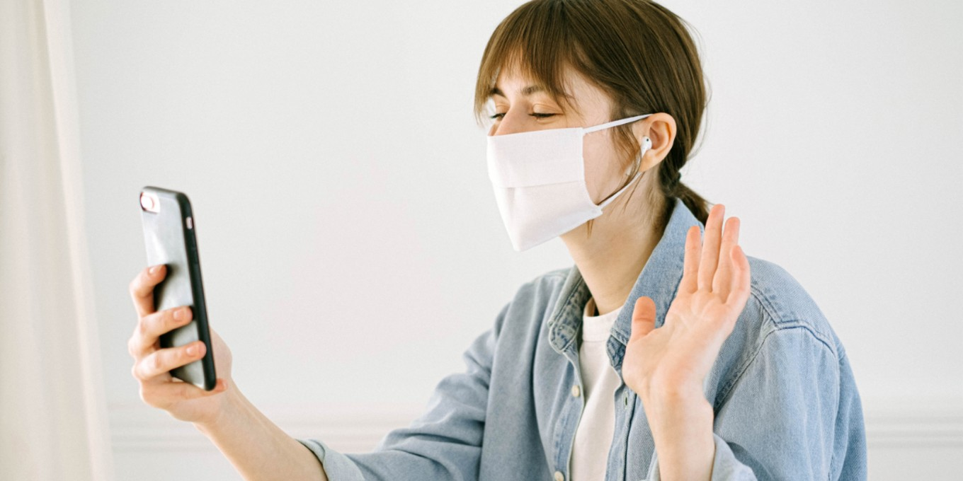 bonwoman-in-face-mask-having-video-call-4240583
